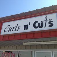 Curls N' Cuts Salon logo