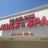 95 Deluxe Nails & spa logo