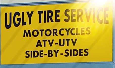 Ugly Tire Service logo